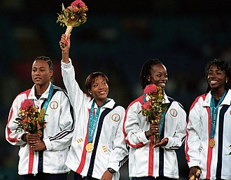 Athletics at the 2000 Summer Olympics – Women's 4 × 400 metres relay - The American squad with gold medals (l to r): Jones, Colander, Hennegan, Miles Clark