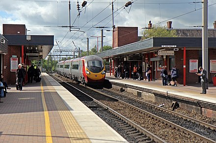 "Wigan North Western railway station Virgin Class 390, 390112 ""Virgin Star"", Wigan North Western railway station (geograph 4499951).jpg"