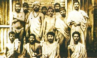 Mahendranath Gupta - Group photo taken on 30 January 1887 In Baranagar Math, Kolkata. Standing: (l–r) ) Swami Shivananda, Swami Ramakrishnananda, Swami Vivekananda, Randhuni, Debendranath Majumdar, Mahendranath Gupta (Shri M), Swami Trigunatitananda, H.Mustafi  Sitting: (l–r) Swami Niranjanananda, Swami Saradananda, Hutko Gopal, Swami Abhedananda