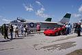 Vought F-8K Crusader 146985 Ferrari F430 Spider LSideFronts crowd TICO 13March2010 (14412931537).jpg