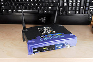 Linksys WRT54G router with top-mounted interna...