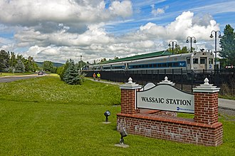 Wassaic station - Train departing the station, seen from its entrance road to the south