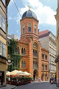 Orange Greek Orthodox church on a city street