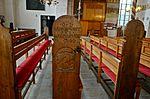 Wismar, Heiligen-Geist Bestuhlung mit beschnitzten Wangen.JPG
