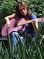 Woman Plays Guitar in Casa de Cultura de Coyoacan - Coyoacan - Mexico City - Mexico (15497048966).jpg