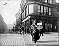 Woman with birdcage at junction of Grafton Street and South King Street (31712974540).jpg
