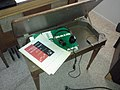 Wurlitzer Model 4100 BW original bench, earphones, and books.jpg