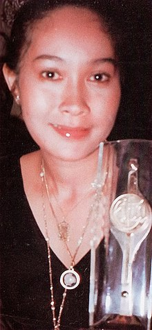 Yenny Rachman with Citra Award, Festival Film Indonesia (1982), 1983, p61.jpg