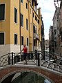 Young woman on a bridge in Venice, Italy - June 2007.JPG