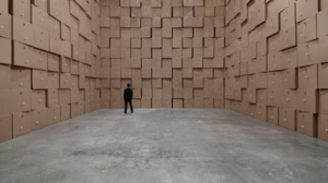 Zimoun - Installation: 658 prepared dc-motors, cotton balls, cardboard boxes 70x70x70cm, Zimoun 2017. Installation view: Le Centquatre Paris, France. Curated by José-Manuel Gonçalves.