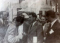 Țepelea and foreign journalists outside Ardealul, with bust of Iuliu Maniu (September 1944).png