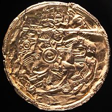 Colour photograph showing the gold Pliezhausen bracteate, which depicts a scene nearly identical to design 2.
