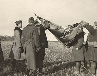 38th Infantry Regiment (United States) - General Joseph Dickman pins the french Croix de Guerre to the 38th flag in 1919