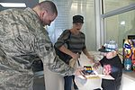 163d MXS delivers holiday cheer 121214-F-UF872-007.jpg