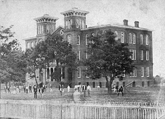 History of the Alabama Cooperative Extension System - The Old Main in Auburn, for nearly three decades, except for the Civil War interruption, the hub of student life at East Alabama Male College and, later, the Agricultural and Mechanical College of Alabama, established by the Morrill Act of 1862.  It is shown here as it appeared in 1883, four years before it burned and was replaced by a new main building, later named Samford Hall.