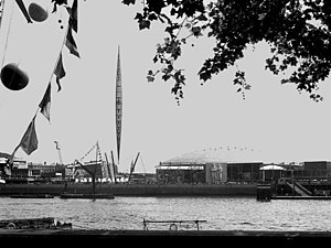 Festival of Britain - A view of the South Bank Exhibition from the north bank of the Thames, showing the 300-foot tall  Skylon and the Dome of Discovery.