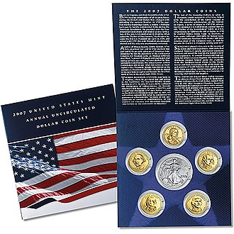 "American Silver Eagle - The 2007 ""United States Mint Annual Uncirculated Dollar Coin Set"" with a Silver Eagle coin surrounded by Presidential and Sacagawea dollars."