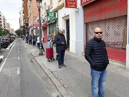 Residents of Valencia, Spain, maintaining social distancing while queueing