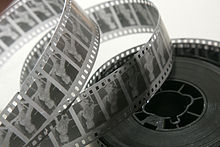 A reel of 35 mm black & white movie film negative stock