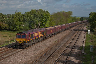 DB Cargo UK - EWS liveried Class 66 and coal wagons near Tupton, Derbyshire in May 2011