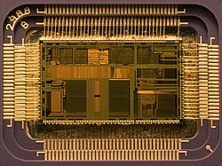 Die of an Intel 80486DX2 microprocessor (actual size: 12×6.75 mm) in its packaging