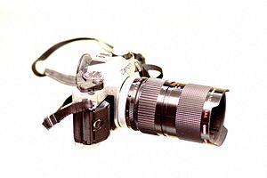 Canon Inc. - AE-1 Film Camera. AE stood for Automatic Exposure.