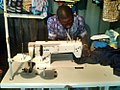 A Nigerian fashion designer at work.jpg