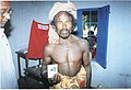 A Tribal person displaying his Photo Identity Card at the polling booth at Koraput in Orissa during the first phase of General Elections-2004 on April 20, 2004.jpg