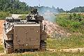 A U.S. Marine Corps amphibious assault vehicle with 3rd Platoon, Charlie Company, 2nd Assault Amphibian Battalion fires its .50-caliber automatic machine gun during a gunnery training in Fort A.P. Hill, Va 130601-M-BW898-001.jpg