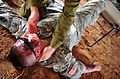 A U.S. Soldier with simulated injuries receives treatment from an Israeli soldier during a medical exercise 121022-F-QW942-037.jpg