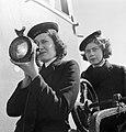 A Wren transmitting messages using an Aldis lamp in 1944. D19088.jpg