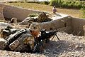 A member of 8 Platoon, 3rd Battalion, The Parachute Regiment. Shown here taking up a defensive position, whilst colleagues conduct a vehicle and foot patrol near Goreskh, Helmand Province, Afghanistan. MOD 45146334.jpg