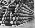 A woman war worker checks over 1,000-pound bomb cases before they are filled with deadly charges of explosives and... - NARA - 535575.tif