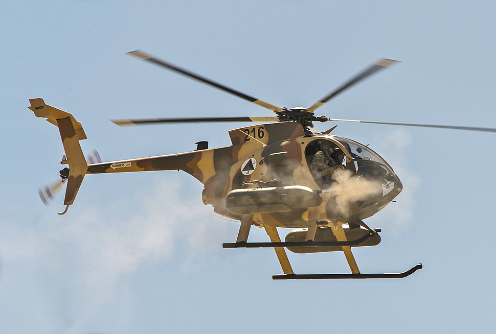 Afghan Air Force MD-530F helicopter fires machine guns