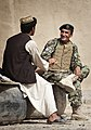 Afghan National Army Capt. Wahid Dullah, the executive officer of Headquarters and Service Company, 2nd Kandak, 1st Brigade, 215th Corps, speaks with a local man while ANA soldiers and U.S. Marines from 3rd 120401-M-MM918-007.jpg
