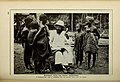 African Chief teaching native children, 1915.jpg
