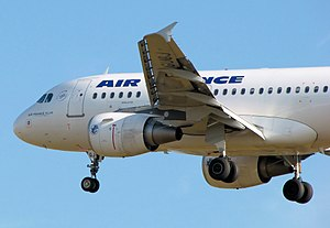 Aircraft registration - Air France Airbus A318 displaying registration F-GUGJ on the wing undersurface and the last two letters of the registration, GJ, on the nose wheel doors.