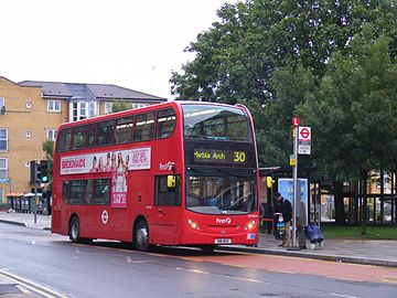 All Change on the 30 route,Eastway, E9. First London takes over. Early morning bus, 25 June 2011.jpg