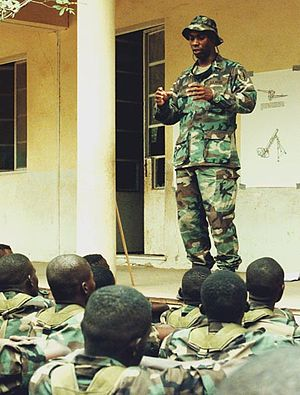African Contingency Operations Training and Assistance - American soldier instructing Senegalese soldiers on U.N. peacekeeping policies during training for the African Crisis Response Initiative in Thiès, Senegal.