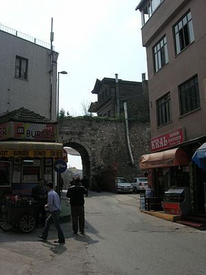 Vefa - A street in Vefa, with an arch of the eastern section of the Valens Aqueduct in background. Behind it lies the Mosque of Kalenderhane.