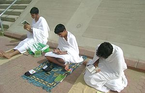 Ihram clothing - Boys wearing Ihram clothing supplicate during Arafat.
