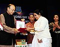 Arun Jaitley honoring the wife of a DRI Martyr as a mark of respect, at the Diamond Jubilee Celebrations of the Foundation Day of Directorate of Revenue Intelligence (DRI), in New Delhi.jpg