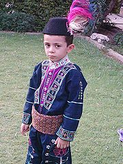Assyrian child wearing the traditional assyrian clothing