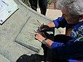 Astronauta Marcos Pontes no Aeroclube de Bauru, dando um autógrafo em frente ao monumento em sua homenagem, colocada no local em que Marcos quando criança vinha observar junto com seu irmão L - panoramio (1).jpg