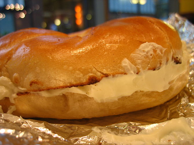 A tasty looking bagel with cream cheese.