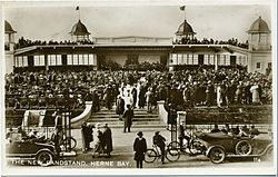 Bandstand with brass band and audience in 1925