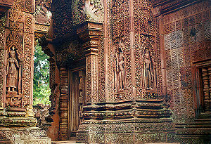 Banteay Srei - Many niches in the temple walls contain carvings of devatas or dvarapalas.