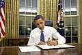 Barack Obama signs emergency declaration for Arkansas 1-28-09.jpg