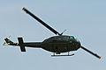 Bell UH-1H Huey 72-21509 129 G-UHIH (9526473820).jpg