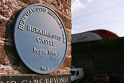Berkhamsted castle blue plaque with virgin train